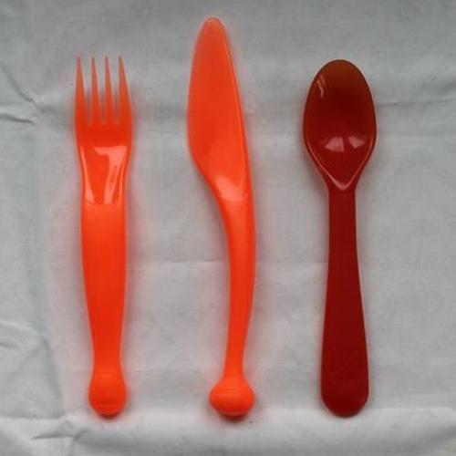 oranssit aterimet haarukka veitsi lusikka muovia