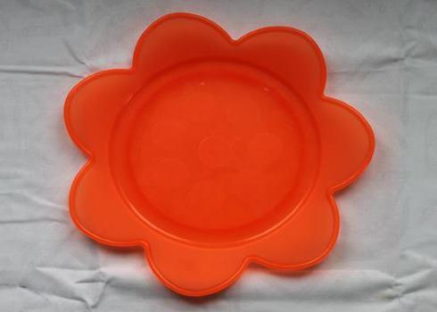 oranssi muovi kukka lautanen